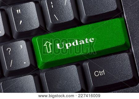 Conceptual Keyboard With Update Green Key Label Inscription. It Security Concept. Close Up View