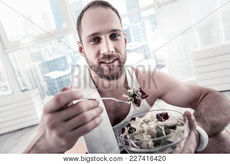 Fast Making Salad. Sincere Strong Glad Sportsman Consuming Salad For Receiving Vitamins And Staring