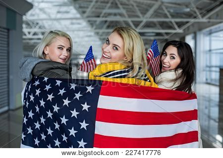 Patriotism Concept. Enjoyed Group Of Girls Going Abroad. They Are Posing Wrapped In National Colors