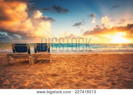 Beach Chairs On The Tropical Carribean Beach And Beautiful Sunrise