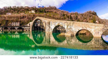 Ponte della Maddalena- picturesque scenery with ancient bridge known as Devil's bridge, near Lucca. Tuscany.Italy