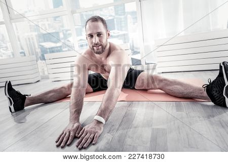 Last Thing. Inspired Thoughtful Reflective Sportsman Stretching After Finishing Workout And Looking