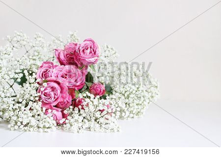 Wedding Styled Stock Photo. Still Life With Pink Roses And Baby's Breath Gypsophila Flowers On White