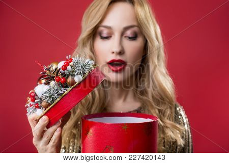 I Cannot Wait Anymore. Portrait Of Serene Female Person Opening Box With Present. Focus On Case. Iso