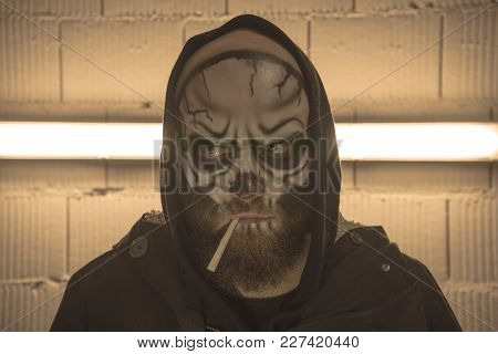 Skull With A Cigarette. A Bald Guy With A Beard With A Makeup Skull. A Man With A Makeup Skull. A Te
