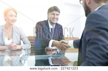 Handshake of successful business people