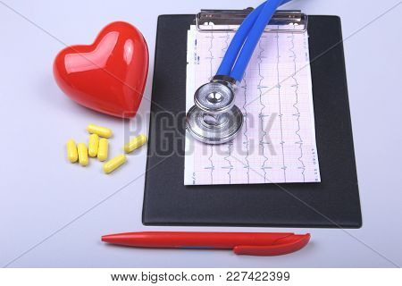 Stethoscope, Red Heart, Rx Prescription And Assorted Pills On White Table With Space For Text