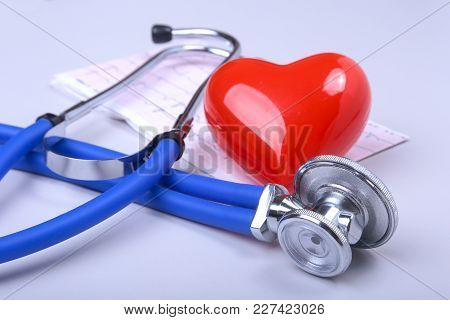 Stethoscope, Rx Prescription, Red Heart And Assorted Pills On White Table With Space For Text