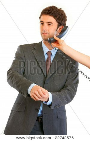 Elegant Young Businessman Talking On Phone In Hand Of Secretary