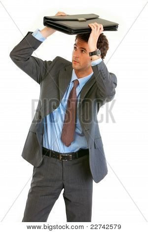 Scared Young Businessman Holding Briefcase Over  Head
