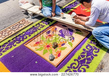 Antigua, Guatemala -  April 13, 2017: Decorating Holy Thursday Dyed Sawdust Procession Carpet In Tow