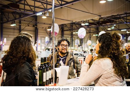 Strasbourg, France - Feb 19, 2018: Hispanic Male Tasting And Buying French Wine At The Vignerons Ind