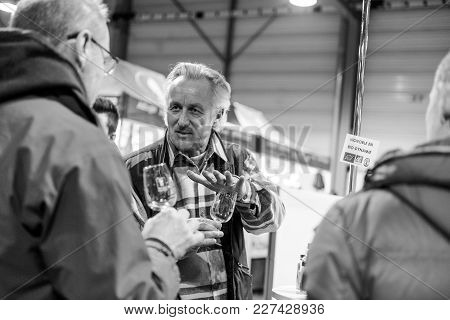 Strasbourg, France - Feb 19, 2018: Man Selling Explaining To Customers Tasting Buying French Wine At