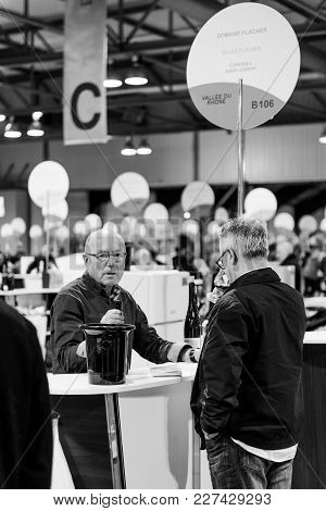 Strasbourg, France - Feb 19, 2018: Senior Customers Tasting And Buying French Wine At The Vignerons