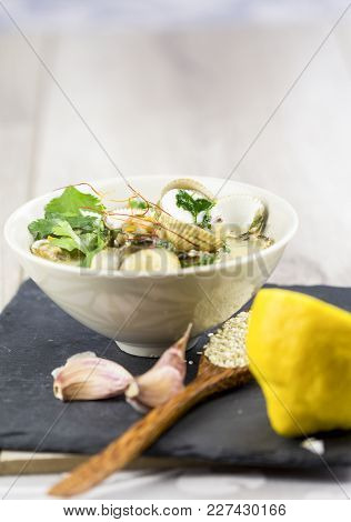 Bowl Of Delicious Savory Seafood Ragout With Fresh Coriander Leaves, Shellfish, Garlic And White Win