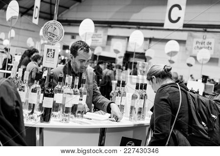 Strasbourg, France - Feb 19, 2018: Adult Woman Tasting And Buying French Wine At The Vignerons Indep