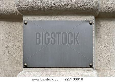 Empty Silver Plaque Panel At Building Exterior