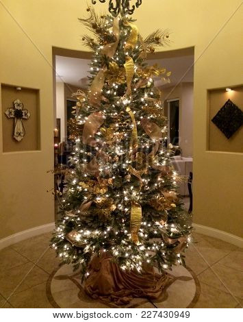 Beautifully wrapped presents beneath a Christmas tree in a modern home.