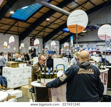 Strasbourg, France - Feb 19, 2018: Bald Male Buying Tasting French Wine At The Vignerons Independant
