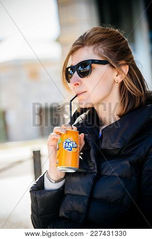 Lisbon, Portugal - Feb 10, 2018 Beautiful American Woman Drinking Fanta Soda Juice Can Through Straw