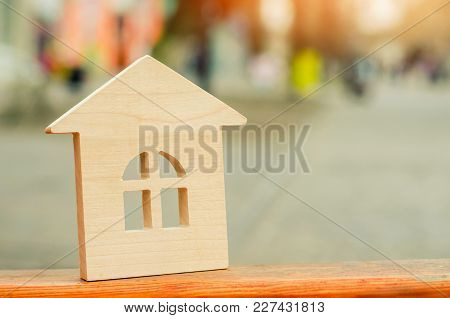 Miniature Wooden House. Concept Of Real Estate. Sale Of Apartments. Purchase Of Housing. Apartments