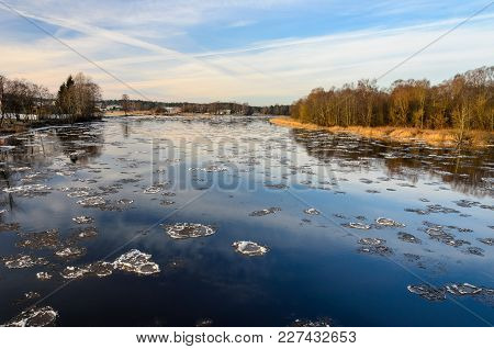 The Ice Floes On The River In Winter.  A View From The Bridge.