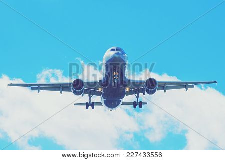 The plane on a background of blue sky and white clouds.The plane on a background of blue sky and whi