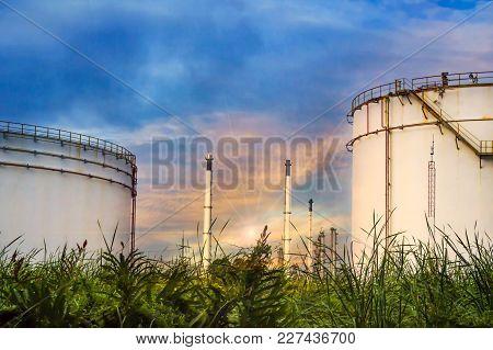 Distillation Tank Of Oil Refinery Plant, Twilight Time.