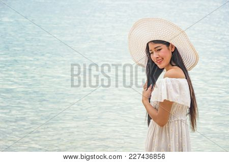 Happy Woman At The Beach Enjoying Her Summer Holidays.