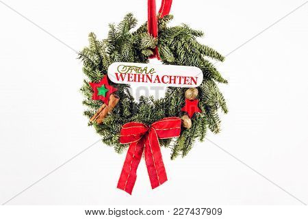Christmas Wreath Of Fir Branches And German Text