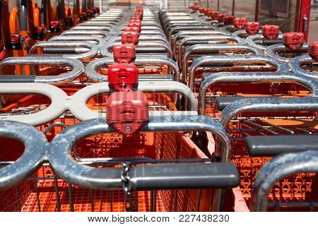 Lot Of Shopping Trolleys In Detail. Shot Outdoor.