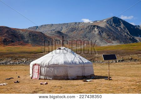 Traditional Mongolian portable round tent ger covered with white outer cover powered by solar panel in Altai Mountains of Western Mongolia