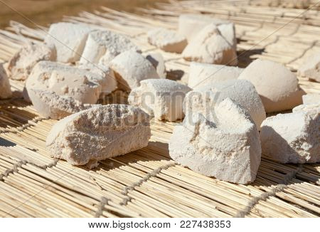 Mongolian dairy product Aaruul or Gurt made from drained sour milk drying on sun