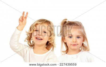 Two very like brothers isolated on a white background