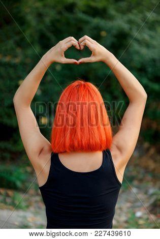 Girl making a heart shape symbol for love