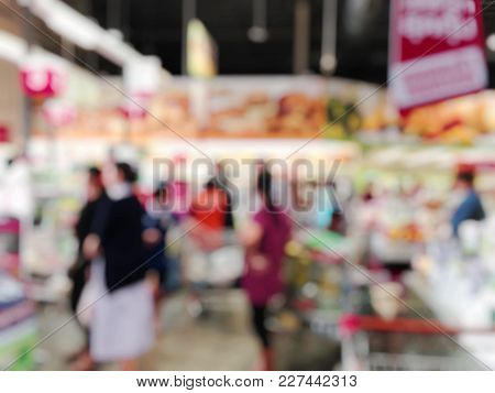 Blurred Image Of Cashier With Woman At Check-out Counter Of House And Hardware Department Store, Hom