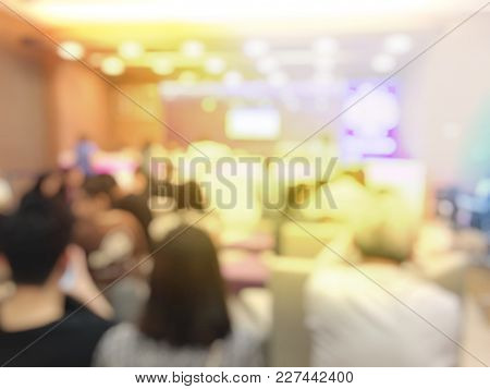 Blurred Image Background Of Business Or Audience People Sitting In Conference Hall Or Seminar Room O