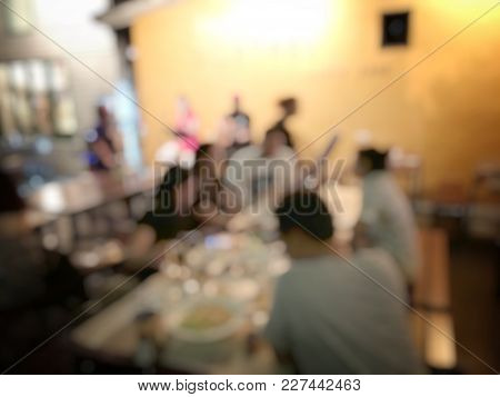 Blurred Image Of Group Business Drinking At Restaurants In Night Time.