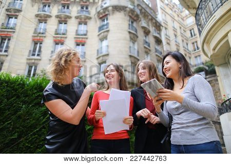 International Students Paying By Tablet With Card In   With University Building Background. Concept