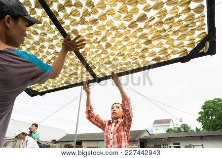 Kien Giang, Vietnam - Dec 6, 2016: Yellowstripe Scad Fish Is Drying Outdoor Under Sunlight In Mekong