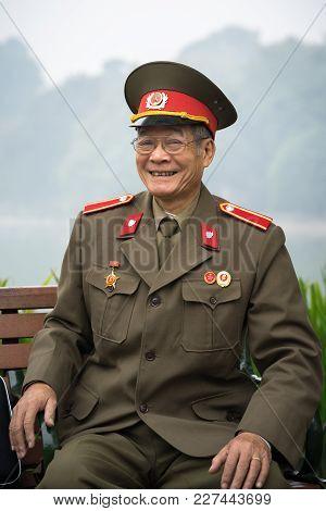 Hanoi, Vietnam - Dec 19, 2016: Portrait Of Old Vietnamese Veteran Sitting At Hoan Kiem Lake, Center