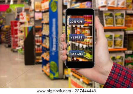 Augmented Reality In Marketing. Phone In Hand, On Screen Information About Prices And Sales In Food