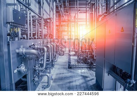 Industrial Background. Pipeline And Valve System In Brewery For Ingredients Delivery.
