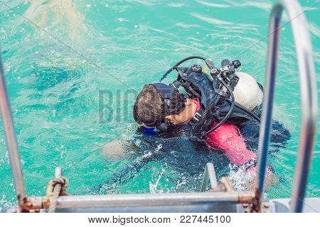 Divers On The Surface Of Water Ready To Dive