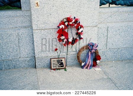 Memorial Flower Wreath Laid At The World War Two Memorial For Memorial Day Weekend In Washington, D.