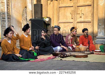 Hanoi, Vietnam - Jun 22, 2017: Folk Music Band Sitting On Courtyard Of Communal House At So Village,