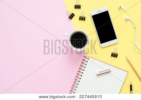 Office Desk Working Space - Flat Lay Top View Of Working Space With White Blank Notebook, Earphone,