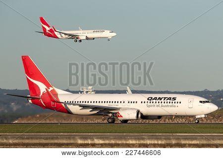 Sydney, Australia - May 5, 2014: Qantas Boeing 737 At Sydney Airport With Another Qantas 737 Landing