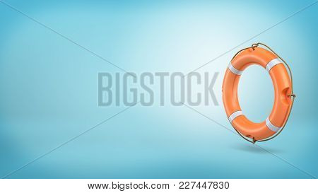 3d Rendering Of A Single Orange Life Buoy With A Rope Over Its Sides Stands Vertically On A Blue Bac