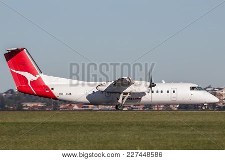 Sydney, Australia - May 6, 2014: Qantaslink Dehavilland Dhc-8 (dash 8) Twin Engined Regional Airline